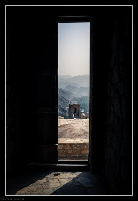 Beyond the door.