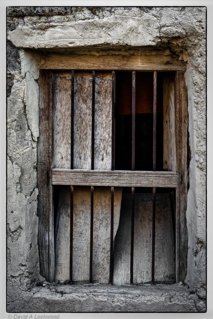Window in derelict house.